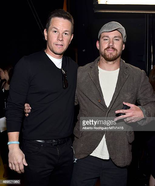 Actors Mark Wahlberg and Channing Tatum attend The 2015 MTV Movie Awards at Nokia Theatre LA Live on April 12 2015 in Los Angeles California