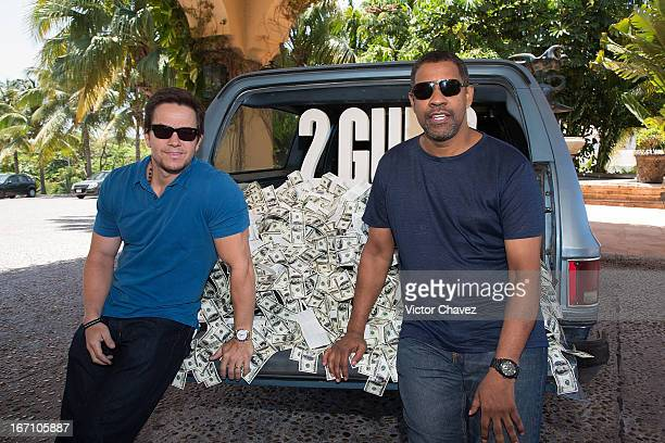 Actors Mark Wahlberg and Denzel Washington attend the '2 Guns' photocall during the 5th Annual Summer Of Sony on April 20, 2013 in Cancun, Mexico.