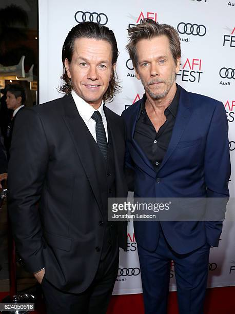Actors Mark Wahlberg and Kevin Bacon attend the premiere of 'Patriots Day' at AFI Fest 2016 presented by Audi at The Chinese Theatre on November 17...