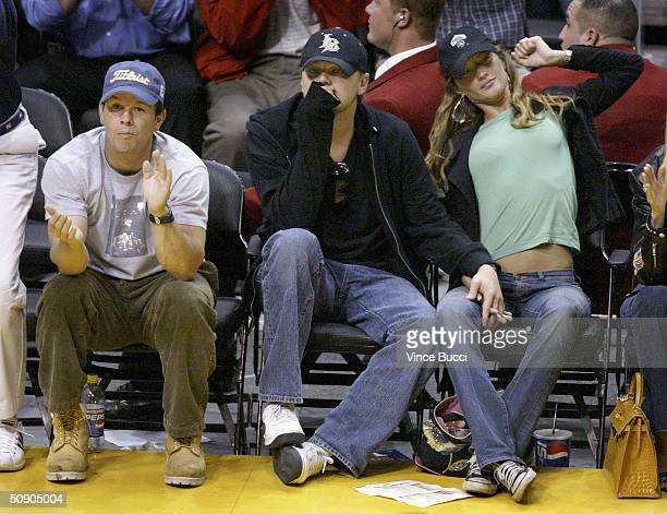 Actors Mark Walberg and Leonardo DiCaprio and girlfriend model Gisele Bundchen attend Game 4 of the NBA Western Conference Finals between the...