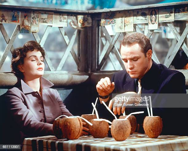 Actors Marlon Brando as Sky Masterson and Jean Simmons as Sarah Brown sharing a few drinks in Havana in the musical film 'Guys and Dolls' 1955