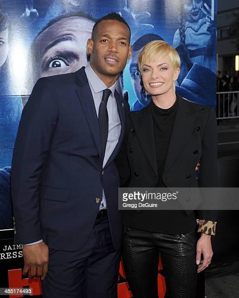 Actors Marlon Wayans and Jaime Pressly arrive at the Los Angeles premiere of 'A Haunted House 2' at Regal Cinemas LA Live on April 16 2014 in Los...