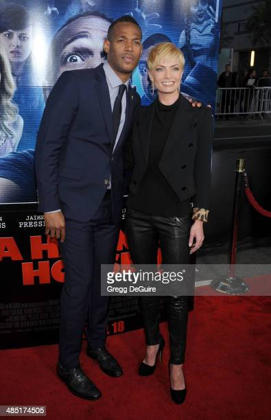 """Actors Marlon Wayans and Jaime Pressly arrive at the Los Angeles premiere of """"A Haunted House 2"""" at Regal Cinemas L.A. Live on April 16, 2014 in Los..."""