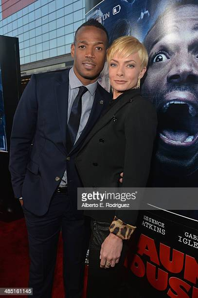 Actors Marlon Wayans and Jaime Pressly arrives to the premiere of Open Road Films' 'A Haunted House 2' at Regal Cinemas LA Live on April 16 2014 in...