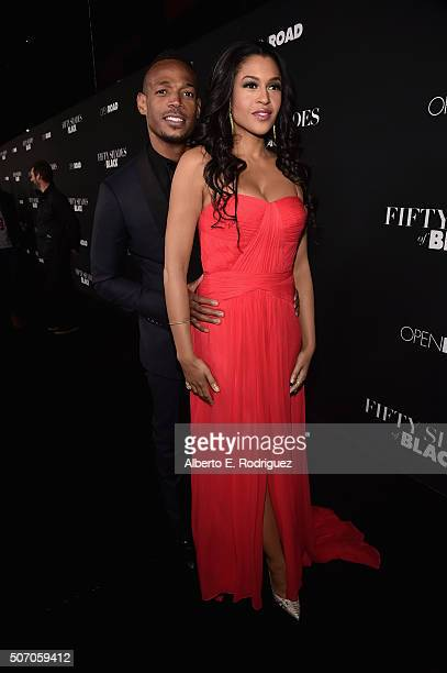 Actors Marlon Wayans and Kali Hawk attend the premiere of Open Road Films' Fifty Shades of Black at Regal Cinemas LA Live on January 26 2016 in Los...