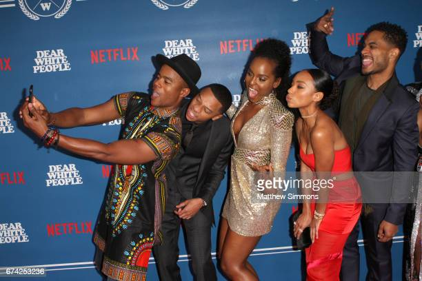 Actors Marque Richardson DeRon Horton Antoinette Robertson Logan Browning and Brandon P Bell take a selfie attends the premiere of Netflix's 'Dear...