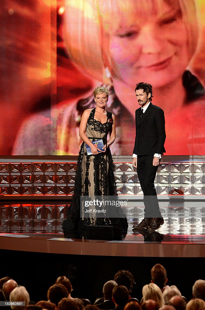 Actors Martha Plimpton (L) and Jeremy Davies onstage during the 64th Primetime Emmy Awards at Nokia Theatre L.A. Live on September 23, 2012 in Los Angeles, California.