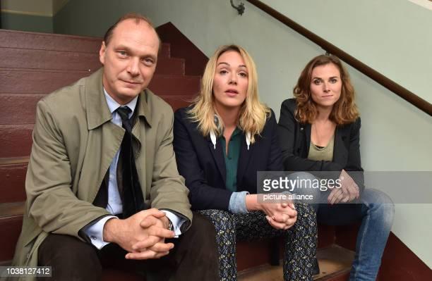 Actors Martin Brambach Alwara Hoefels and Karin Hanczewski pose at a set where an episode entitled 'Auf einen Schlag' of German television crime...