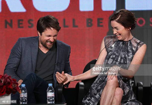 Actors Martin Henderson and Julianne Nicholson speak onstage during the 'Sundance Channel - The Red Road' panel discussion at the AMC/Sundance...