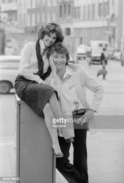 Actors Martin Shaw and Gemma Craven stars of the stage musical 'They're Playing Our Song' pose outside the Shaftesbury Theatre in London during a...