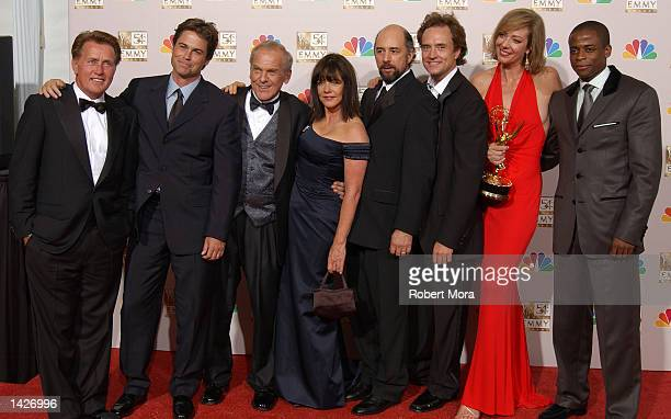 Actors Martin Sheen Rob Lowe John Spencer Stockard Channing Richard Schiff Bradley Whitford Allison Janney and Dule Hill pose backstage during the...