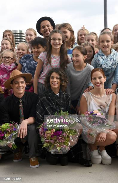 Actors Martina Stoessel Facundo Gambande and Candelaria Molfese pose at a photoshoot for Disney TV show Violetta in Cologne Germany 4 September 2015...