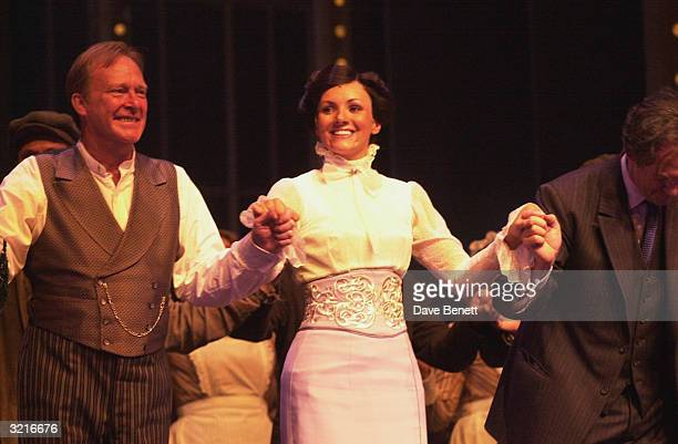 Actors Martine McCutcheon Dennis Waterman and Jonathan Pryce take a curtain call on stage at the West End opening night of 'My Fair Lady' starring...