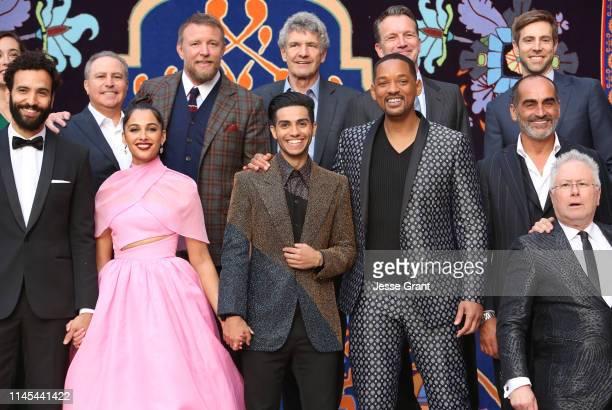 Actors Marwan Kenzari Naomi Scott Mena Massoud Will Smith Navid Negahban and Composer Alan Menken CoChairman The Walt Disney Studios Alan Bergman...
