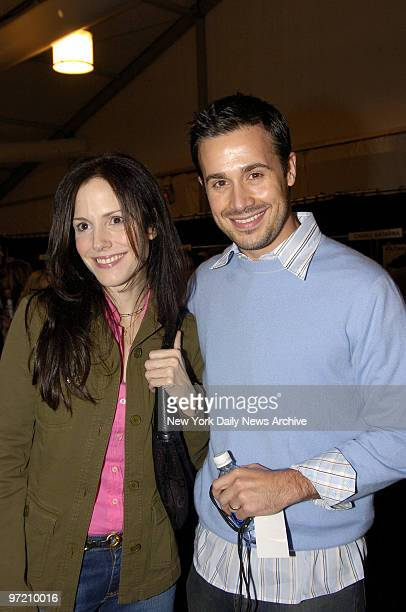 Actors Mary Louise Parker and Freddie Prinze Jr are on hand backstage at the Tent in Bryant Park during a Fashion Week runway show featuring the...