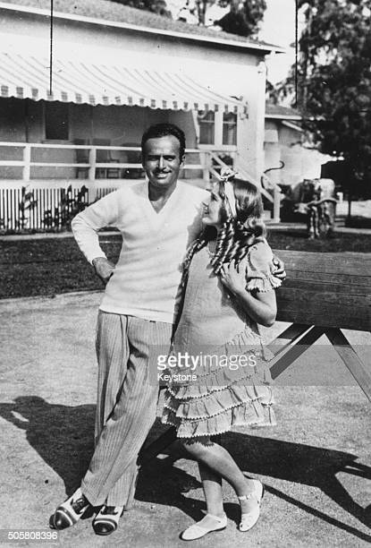 Actors Mary Pickford and Douglas Fairbanks Snr arm in arm in the grounds of the Pickford-Fairbanks Studio in Hollywood, CA, 1929.