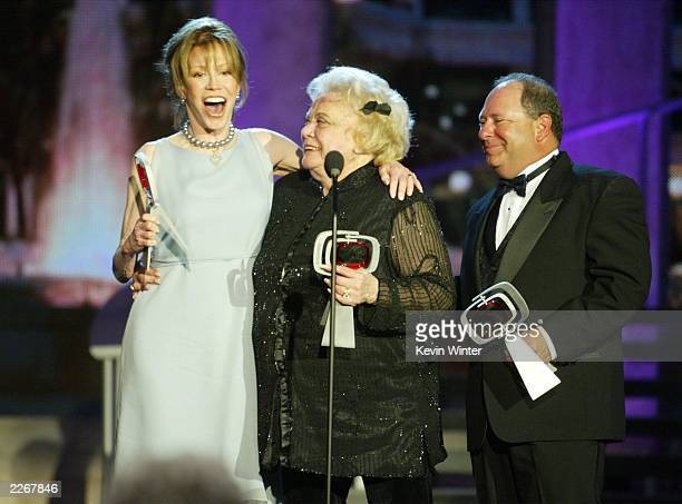 Actors Mary Tyler Moore Rose Marie and Larry Mathews from 'The Dick Van Dyke Show' laugh on stage as they accept their Legend Award during the TV...