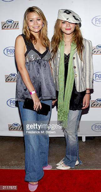 Actors MaryKate and Ashley Olsen attend the grand opening of the Fox Sports Grill at the Irvine Spectrum on June 26 2003 in Irvine California The...