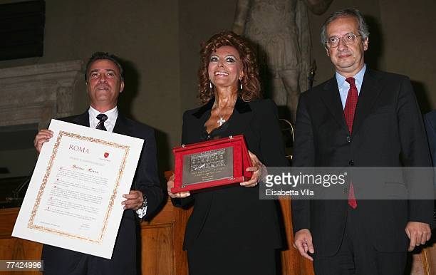 Actors Massimo Ghini Mayor of Rome Walter Veltroni pose with actress Sophia Loren and her lifetime achievement award Il Campidoglio from the city of...