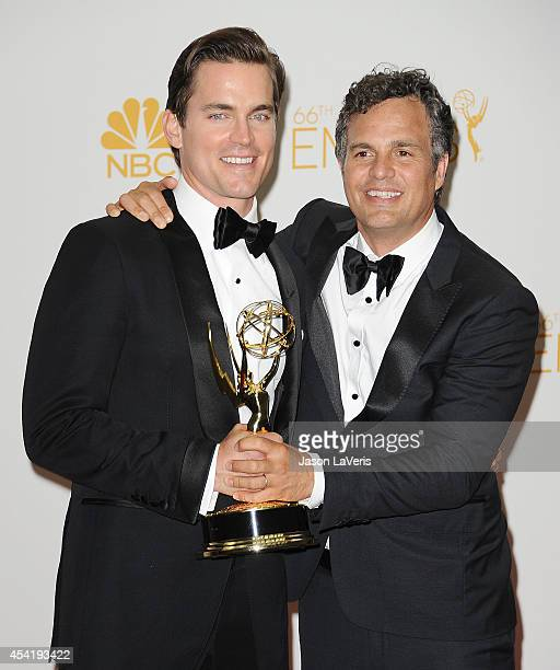 Actors Matt Bomer and Mark Ruffalo pose in the press room at the 66th annual Primetime Emmy Awards at Nokia Theatre LA Live on August 25 2014 in Los...
