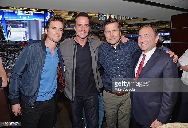 Actors Matt Bomer Tim DeKay Stephen B Burke and Commissioner of the National Hockey League Gary Bettman attend game four of the 2014 NHL Stanley Cup...