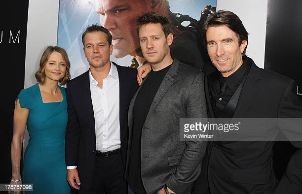 Actors Matt Damon Jodie Foster director Neill Blomkamp and Sharlto Copley attend the premiere of TriStar Pictures' Elysium at Regency Village Theatre...