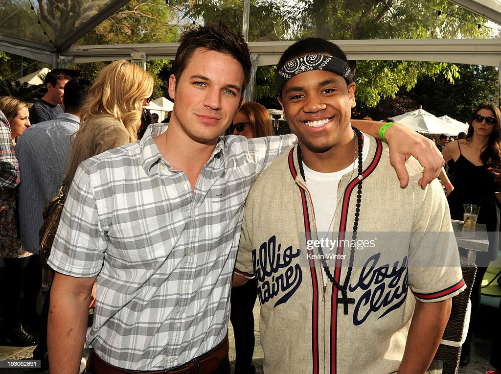 Actors Matt Lanter (L) and Tristan Wilds pose at the CW Network's '90210' Season 5 Wrap Party on March 3, 2013 in Los Angeles, California.