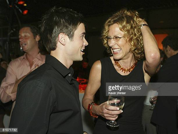 Actors Matt Long and Christine Lahti talk at The WB Network's 2004 All Star Summer Party at the Pacific Design Center on July 14 2004 in West...