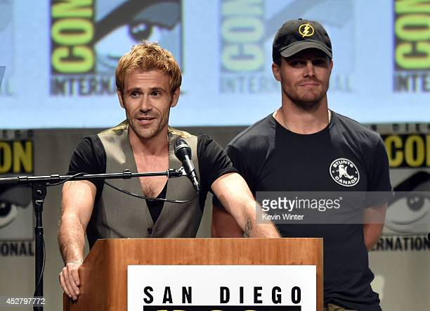 Actors Matt Ryan and Stephen Amell attend Warner Bros Television DC Entertainment world premiere presentation during ComicCon International 2014 at...