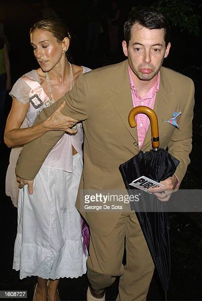 """Actors Matthew Broderick and Sarah Jessica Parker attend a rainy openning night of """"The Seagull"""" August 12, 2001 at the Delacorte Theatre in New York..."""