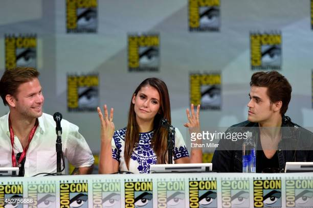 Actors Matthew Davis Nina Dobrev and Paul Wesley attend CW's The Vampire Diaries panel during ComicCon International 2014 at the San Diego Convention...