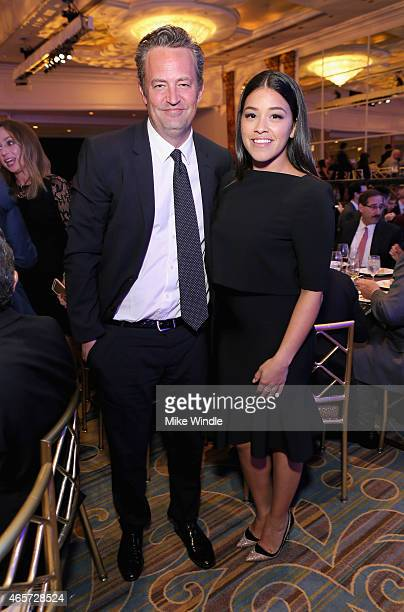 Actors Matthew Perry and Gina Rodriguez attend Venice Family Clinic's Silver Circle Gala at Regent Beverly Wilshire Hotel on March 9 2015 in Beverly...