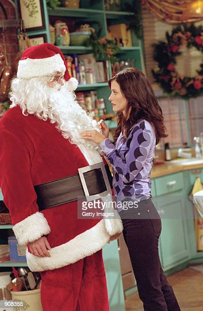 """Actors Matthew Perry as Chandler Bing and Courteney Cox as Monica Geller star in NBC's comedy series """"Friends"""" episode """"The One with the Holiday..."""