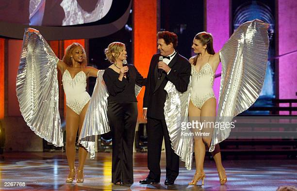 Actors Maureen McCormick and Barry Williams perform during the TV Land Awards 2003 at the Hollywood Palladium on March 2 2003 in Hollywood California