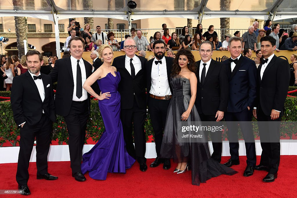Actors Maury Sterling, Michael O'Keefe, Laila Robins, Tracy Letts, Numan Acar, Nimrat Kaur, Mandy Patinkin, Mark Moses, and Raza Jaffrey of 'Homeland' attend the 21st Annual Screen Actors Guild Awards at The Shrine Auditorium on January 25, 2015 in Los Angeles, California.