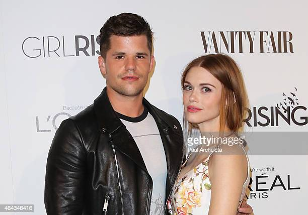 Actors Max Carver and Holland Roden attend the Vanity Fair and L'Oreal Paris Girl Rising benefit at 1 OAK on February 20 2015 in West Hollywood...