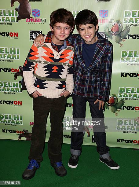 Actors Max Charles and Joshua Rush attend 'Delhi Safari' Los Angeles premiere at Pacific Theatre at The Grove on December 3 2012 in Los Angeles...