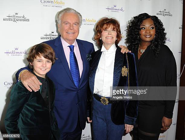 Actors Max Charles, Robert Wagner , Jill St. John and Candice Glover arrive at Hallmark Channel's annual holiday event premiere screening of...