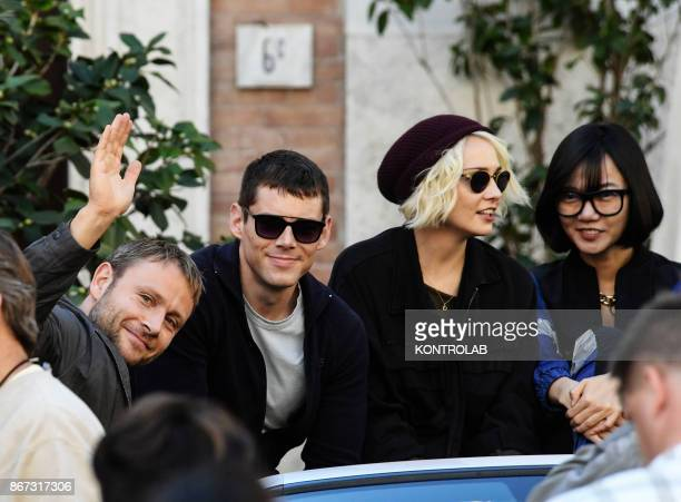 Actors Max Riemelt Brian Jacob Smith Tuppence Middleton and Doona Bae at a break time the set of Netflix TV scifi series 'Sense8' in the Station in...