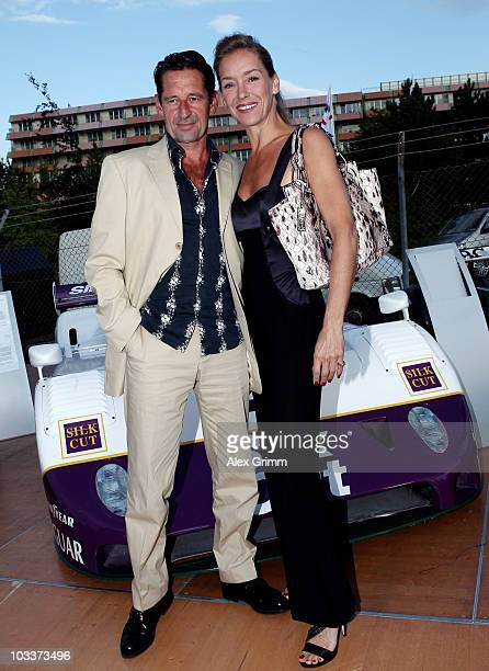 Actors Max Tidof and Lisa Seitz pose during the celebration of British sports cars manufacturer Jaguar's 75 years sporting history at the...