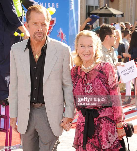 Actors Maxwell Caulfield and Juliet Mills arrive at the Los Angeles premiere of Planes at the El Capitan Theatre on August 5 2013 in Hollywood...