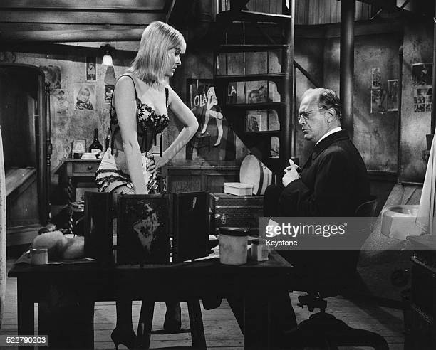 Actors May Britt and Curd Jurgens in a boudoir scene from the movie 'The Blue Angel' 1959