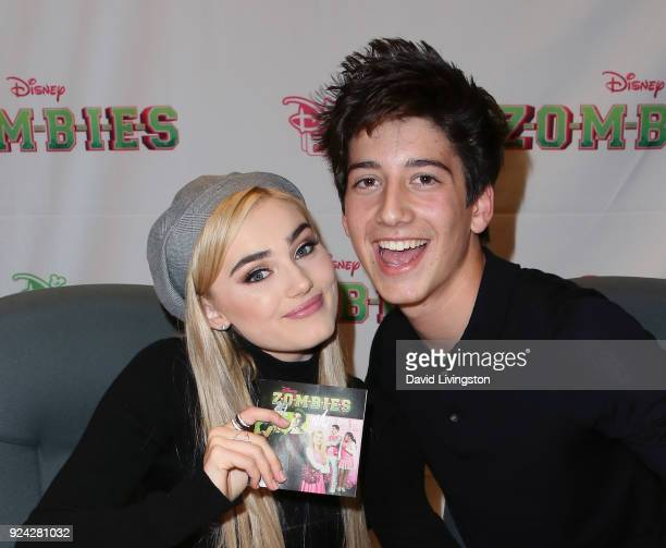 Actors Meg Donnelly and Milo Manheim attend a soundtrack signing for Disney Channel's Zombies at Barnes Noble at The Grove on February 25 2018 in Los...