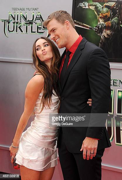 Actors Megan Fox and Alan Ritchson arrive at the Los Angeles Premiere of 'Teenage Mutant Ninja Turtles' at Regency Village Theatre on August 3 2014...