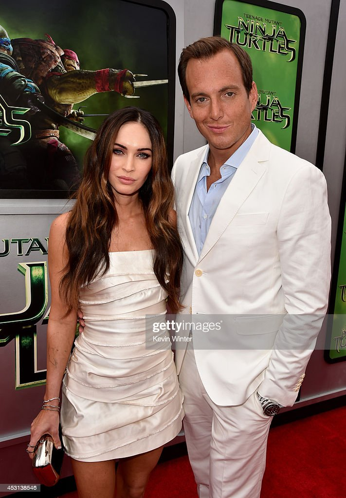 Actors Megan Fox (L) and Will Arnett attend the premiere of Paramount Pictures' 'Teenage Mutant Ninja Turtles' at Regency Village Theater on August 3, 2014 in Westwood, California.