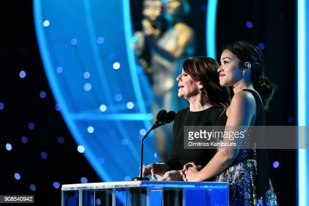 Actors Megan Mullally and Gina Rodriguez onstage during the 24th Annual Screen Actors Guild Awards at The Shrine Auditorium on January 21 2018 in Los...