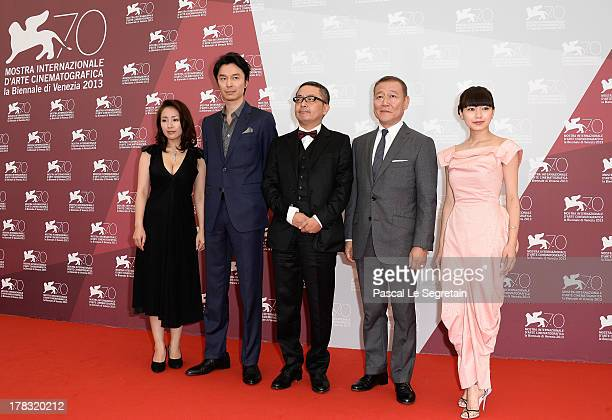 Actors Megumi Kagurazaka Hiroki Hasegawa director Sion Sono Jun Kunimura and Fumi Nikaido attend the 'Why Don't You Play In Hell' Photocall during...