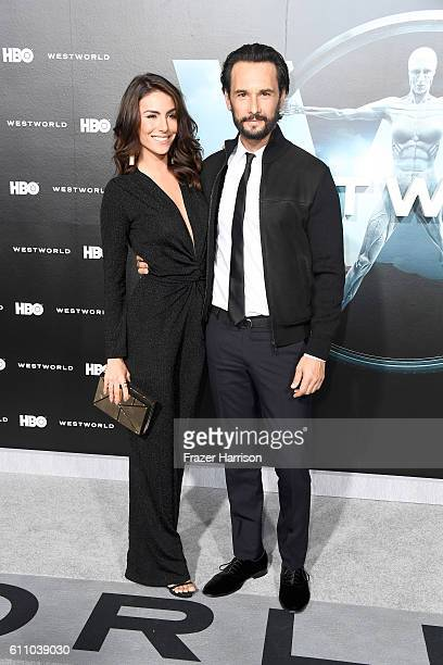 Actors Mel Fronckowiak and Rodrigo Santoro attend the premiere of HBO's 'Westworld' at TCL Chinese Theatre on September 28 2016 in Hollywood...