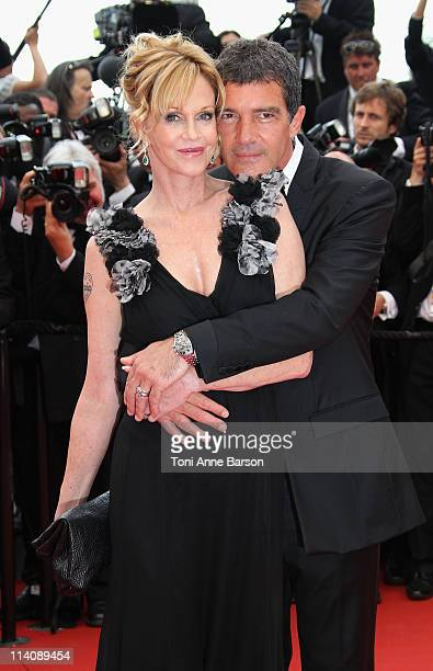 Actors Melanie Griffith and Antonio Banderas attend the Opening Ceremony and 'Midnight In Paris' Premiere at the Palais des Festivals during the 64th...