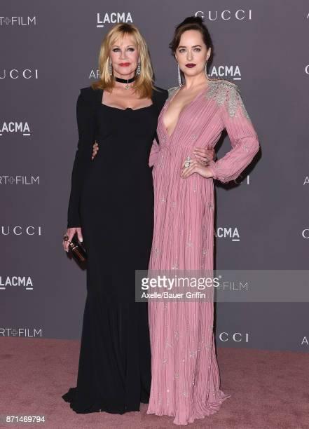 Actors Melanie Griffith and Dakota Johnson arrive at the 2017 LACMA Art + Film Gala at LACMA on November 4, 2017 in Los Angeles, California.
